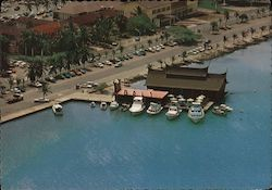 "Aerial view of floating restaurant ""Bali"". Indonesian specialties. Pier with boats"