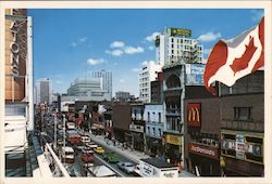 Main Street, McDonalds, Le Strip Live, Imperial Optical, Canada Flag Postcard