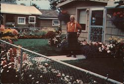 Joe Hembreiker in his front yard Postcard