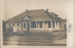 House with wood siding and a porch Postcard