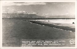 Salton Sea 250 ft. below sea level from Date Palm Beach Calif., San Jacinto and San Gorgonio in distance Postcard