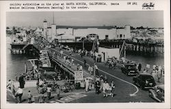 Holiday activities on the pier. Santa Monica Ballroom in the center Postcard