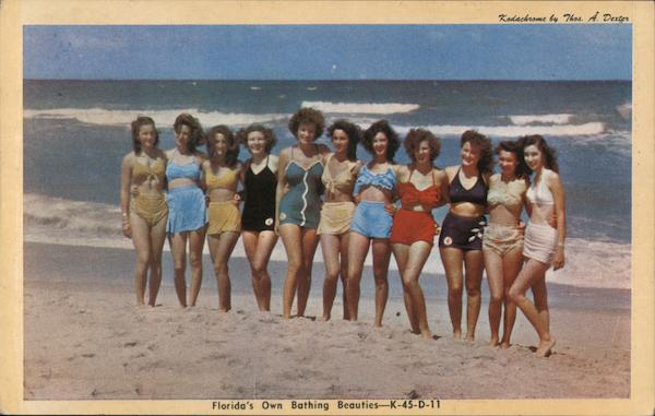 Women in bathing suits standing on the beach Swimsuits & Pinup