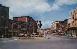 Main Street view, IGA Store, stoplight Postcard