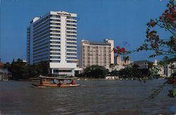 Oriental Hotel, boat on water Postcard