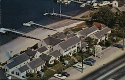 Aerial view of Buzzards Bay Motor Lodge, boat dock, beach