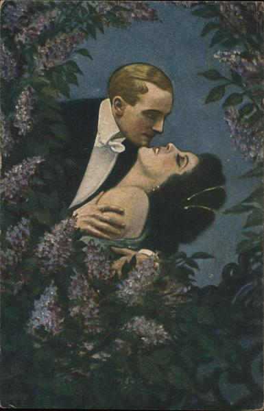 A Man Kissing a Woman Behind Flowers