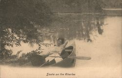 Woman taking Siesta on the Charles River Postcard