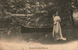 Sunset on the Charles woman with canoe Postcard