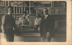 Three men and a woman in a mercantile, Scales Postcard