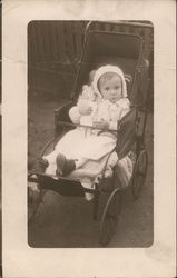 Young Child with a Doll in a Baby Carriage Postcard