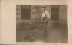 Man With Mutton Chops, Suspenders, Reel Lawnmower Postcard