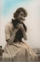 Woman Holding a Black Cat Postcard