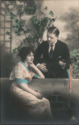 Man Playing a Guitar for a Woman Postcard
