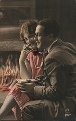 Tinted Photo of Couple Embracing by Fire Postcard