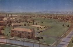 Lowry Air Force Base Showing Family-Type Barracks, Class Rooms, B-29's and The Snow-Capped Rockies