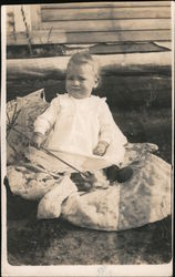 Baby Sitting on a Blanket Holding a Parasol Postcard