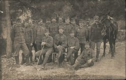 Historical outdoor photo of soldiers with horse. Postcard