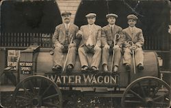 Four Men in Suits, Canes Pose on Water Wagon, West Baden Springs Hotel