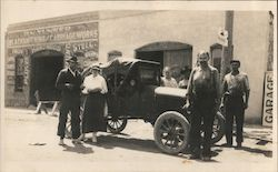 P.N. Yunker Blacksmithing & Carriage Works Men and Woman in Front of Car