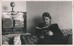 Woman Reading and Listening to the Radio Postcard