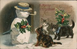 A Merry Christmas - three kittens looking at snowman