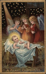 A Merry Christmas-Three angels standing next to the Creche
