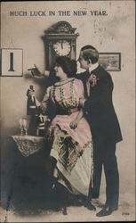 Much Luck in the New Year - photo of couple by clock, toasting with champagne