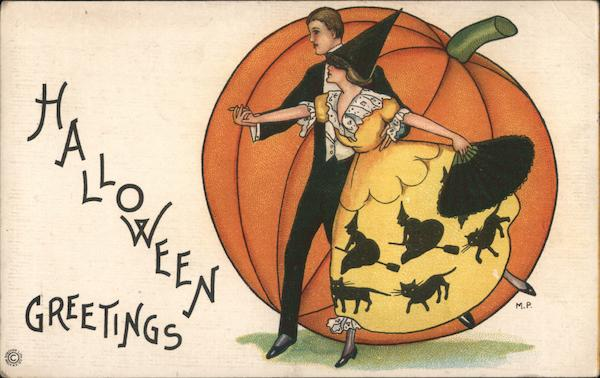 Halloween Greetings-A adult couple dancing in front of a pumpkin