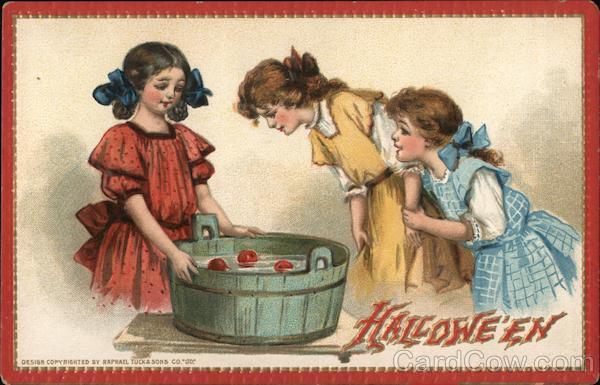 3 girls bobbing for apples Halloween