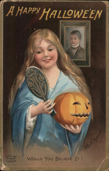 Happy Halloween-Girl looking into a hand mirror holding a jack-o-lantern in front of a picture