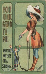 "Cowgirl with captive man: ""You look good to me and you have me on a string"" Postcard"