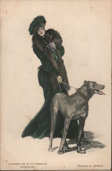 Well dressed Lady in Black walking a tall dog.