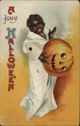 Rare Mechanical Black child in ghost costume, holding orange jack-o-lantern head.