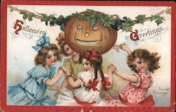 4 girls dancing around a pumpkin on a vine Postcard