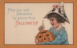 Girl Putting Candle in Jack O'Lantern Postcard