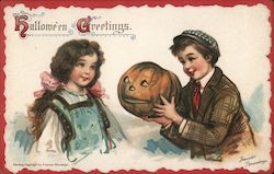 Hallowe'en Greetings-Boy giving girl a jack-o-latern. Postcard