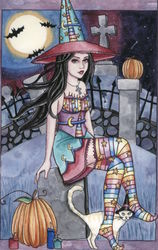 Witch Kamaria Sits in Graveyard with Cat and Pumpkin