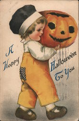 Young child carrying a jack-o-lantern