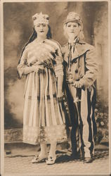 Couple in Patriotic Costumes, Masks, Uncle Sam Postcard