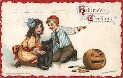 Girl and boy kneeling by a black cat with a jack-o-latern Postcard