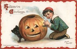Boy Putting Candle in Jack O'Lantern: Hallowe'en Greetings Postcard