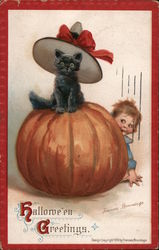 Hallowe'en Greetings - Black kitten sitting on pumpkin with child peeking out from behind. Postcard