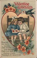 2 Children sitting on a bench looking at a Valentine's card. Surrounded by robins and flowers