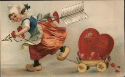 Cupid pulling a Wagon with a heart, to the one I love