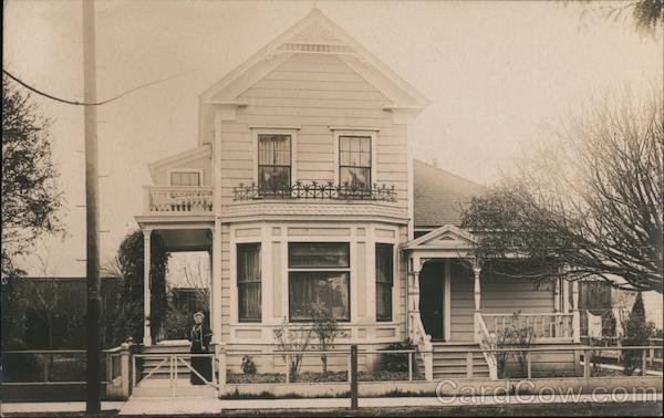 Woman Standing in Front of a Two Story House Campbell California