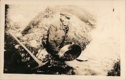 Chinese Man Panning for Gold on the Mother Lode: Placer Mining