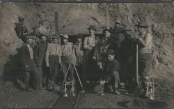 A Group of Men Standing Outside a Mine