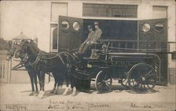 Two Firemen on a Hose Drawn Wagon With Ladder Postcard