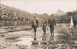 Cal/Stanford Game Three Men Walking Through Mud